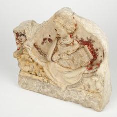 Fragmento de relieve en piedra antiguo - San Juan Evangelista