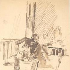 Figura masculina sentada a contraluz