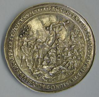 Medalla con la adoración de la serpiente de bronce y el Calvario