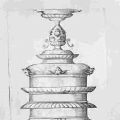 Una copa sobre otra, la superior invertida con cabezas de animales con cuernos