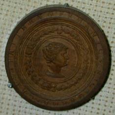 Ficha de Tric Trac con los retratos del emperador Germánico y su esposa Agripina