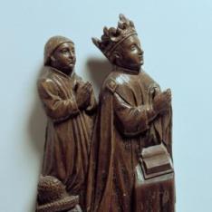Rey donante acompañado por un paje