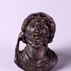 Aplique romano en forma de cabeza