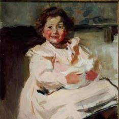 Elena con una muñeca