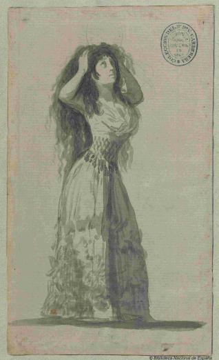 Mujer joven mesándose los cabellos