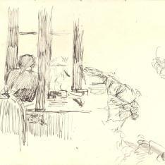Mujer asomada a la ventana