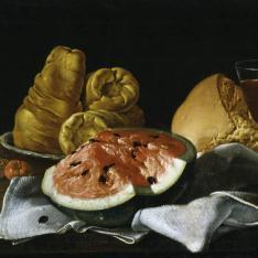 Bodegón: sandías, pan, roscas y copa