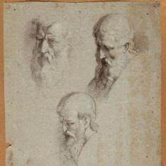 Tres cabezas masculinas con barba