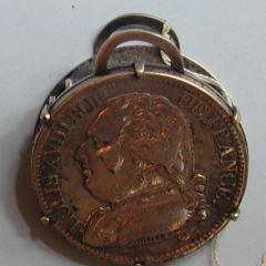 Broche con moneda de 5  francos