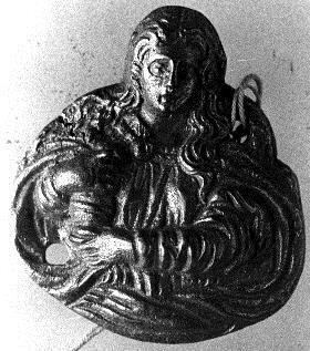 Placa de aplicación con la representación de María Magdalena