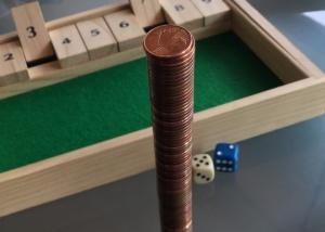El problema clásico de las 100 monedas y las 10 caras