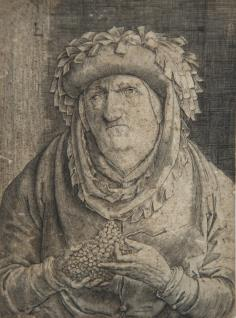 Anciano con un racimo de uvas